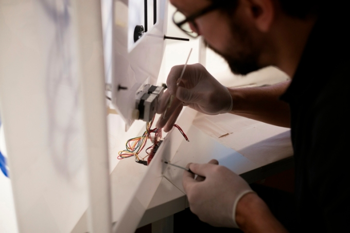 Amer with a digitally generated Analogue Arabesque installation